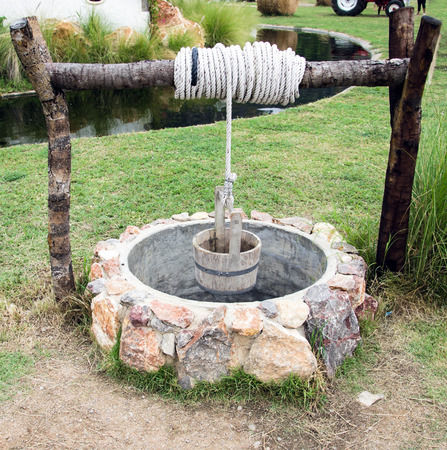 Water Well with Wooden Bucket photo