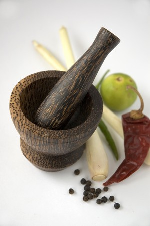 thai pepper: mortar pestle with Thai spices Stock Photo