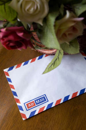 Blank airmail envelope with bouquet of roses Stock Photo