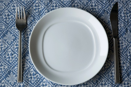 set of dishware on blue texture. Stock Photo