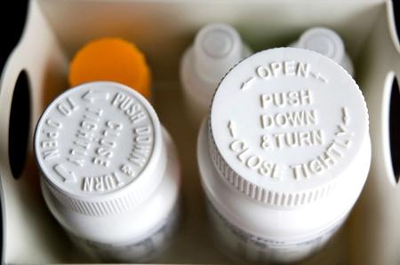 Child proof cap on medicine bottle
