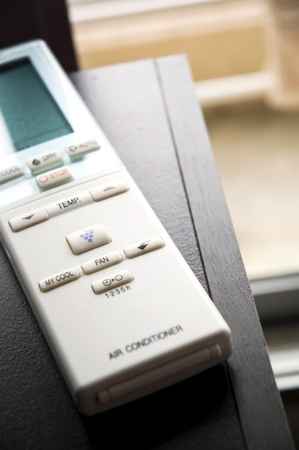 air conditioner remote control put on desk. photo