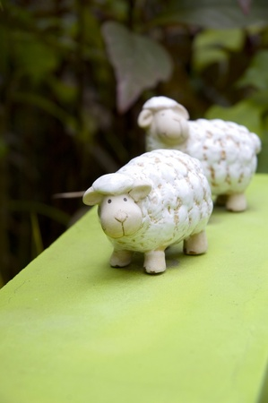 cute sheep ceramic doll in garden photo