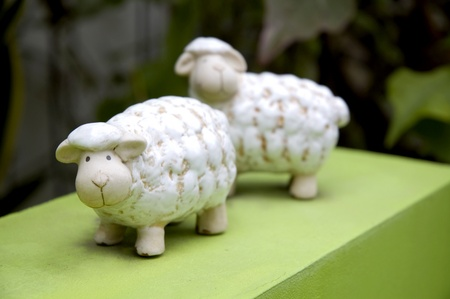 cute sheep ceramic doll on green floor Stock Photo
