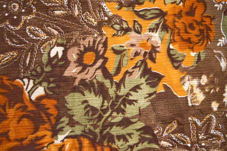 classic colorful floral textile on brown satin fabric photo