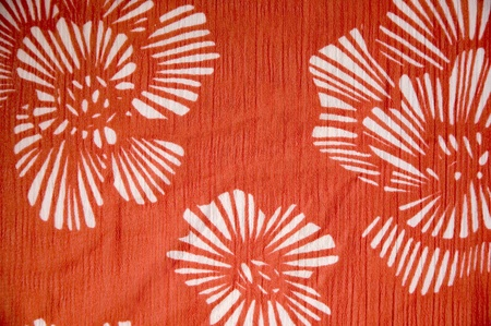 red satin fabric with floral textile