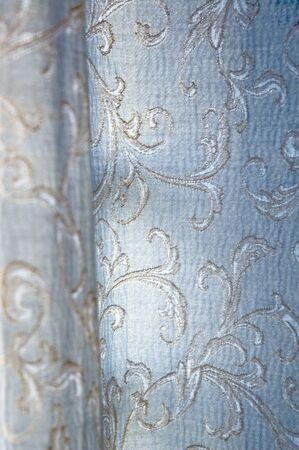 floral detail texture of blue curtain photo