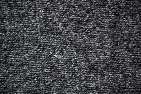 warm cloth: black wool fabric texture background Stock Photo