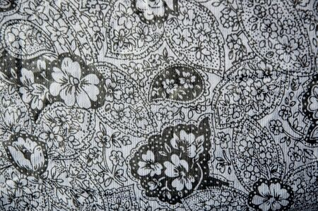 black floral textile on fabric in motif style photo