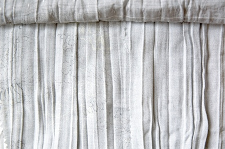 texture of wrinkled white fabric roll photo