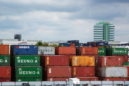 view on top of containers shipping warehouse with business building background at Bangkok,Thailand on August,2010