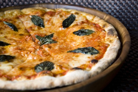close up tasty pizza Margherita on wooden pan photo