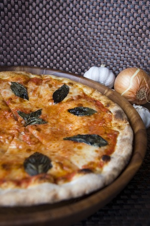 tasty pizza on wooden tray and nature ingredient photo