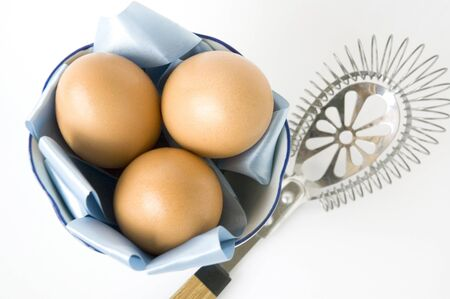 eggs and kitchenware on white background photo