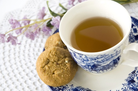 close up blue and white tea set with sweet floral Reklamní fotografie