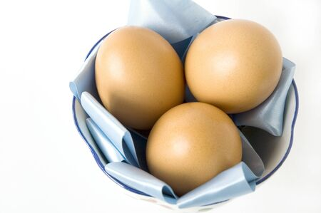 eggs in blue on white background photo