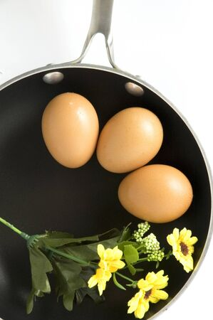 eggs on pan in breakfast concept with blossom floral photo