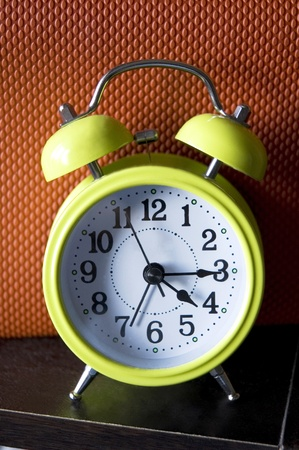 light green color alarm clock with color background photo