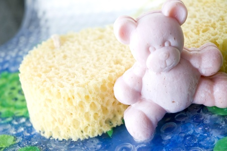 pink teddy bear soap with sponge on bathtime
