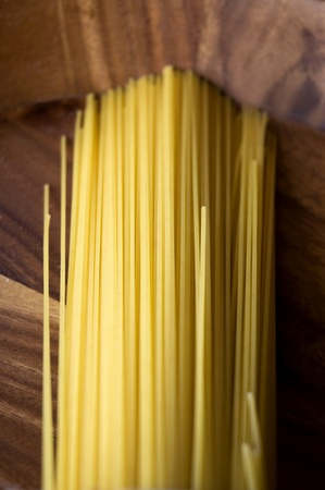 raw linguine pasta put on wooden tray photo