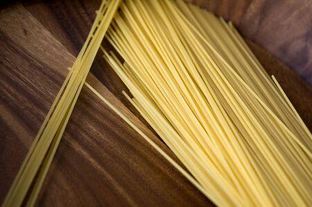 Italian pasta put on wooden tray photo