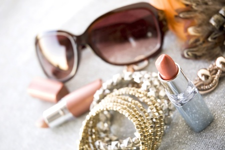 pink lipstick beauty concept with accessories background Stock Photo