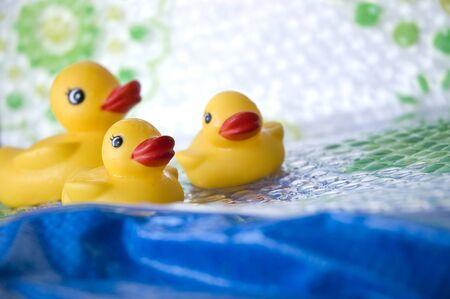 yellow ducks toy family in bathroom photo