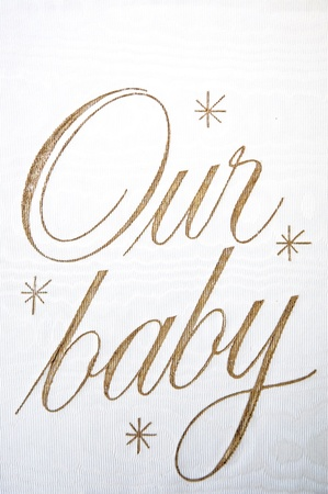ours: close up wording our baby on photobook