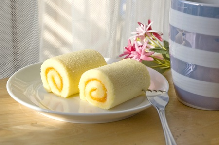 roll cake set put on table with sunlight at noon