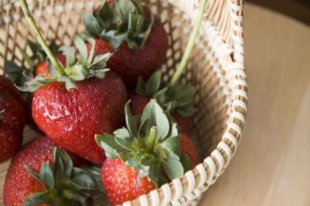 close up fresh strawberry basket photo