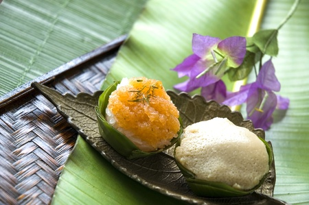Thai dessert on golden plate and banana leaf background photo