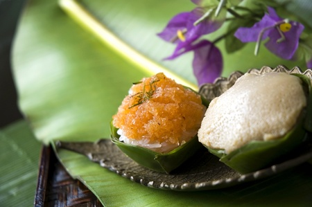 two kinds of Thai dessert on banana leaf photo