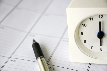 clock at six o clock put on schedule planner photo