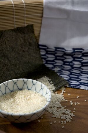 raw japanese rice in bowl with light and shadow photo