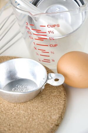 measuring cup: measuring cup with kitchenware and egg