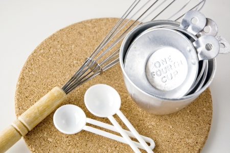 measuring cups with spoon and whisk on board Stock Photo - 15221361