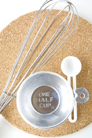 measuring one half cup with spoon on board Stock Photo - 15221390