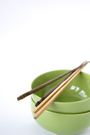 chopstick on green Chinese bowl isolated Stock Photo