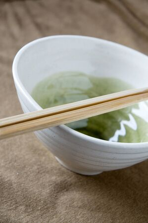 wooden chopstick on white japanese bowl Stock Photo - 15441944