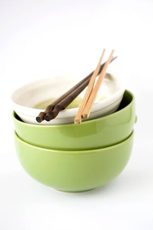 three stack of bowls with chopsticks on white background photo
