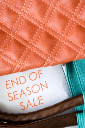 close up text end of season sale with part of colorful bag photo
