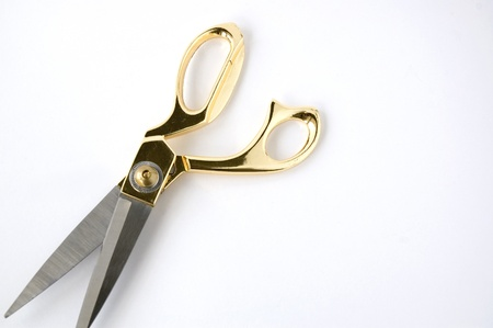 golden scissors on white background Stock Photo