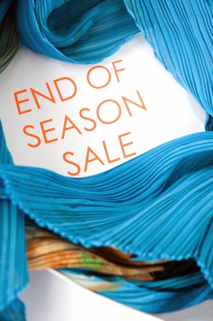 close up text end of season sale with blue clothing