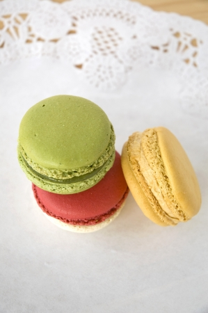 three color french macarons dessert on table photo