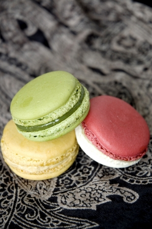french macarons put on black background photo