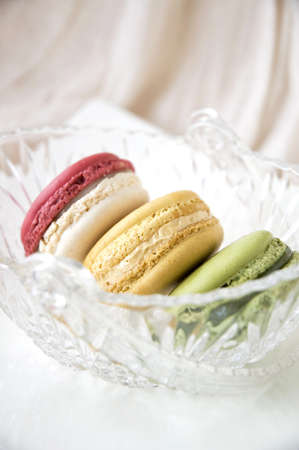 french macarons put in glass basket photo