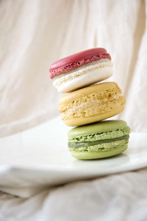 colorful french macarons on white plate photo