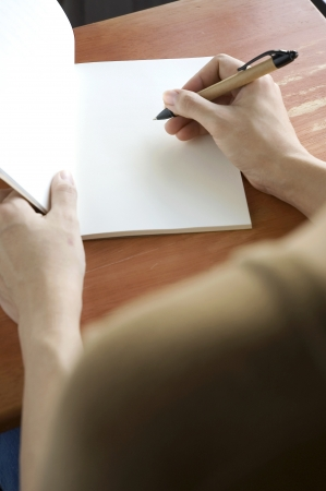 woman open notebook on desk for writing Stock Photo