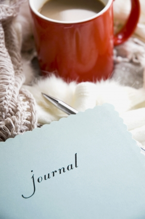 writing activity: blue journal book and coffee in the morning Stock Photo