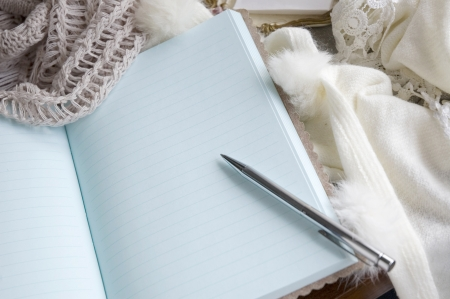 note book put on wool scarf in winter morning Stock Photo